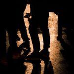 Teens Standing in Shadow