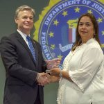 Nandred Navarro Receiving Award from FBI