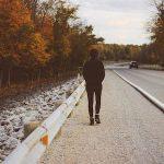 Teen walking on road