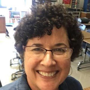 Volunteer Catie smiling happily