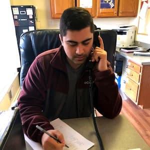Volunteer Husayn Answering Hotline